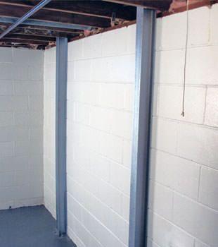 A PowerBrace™ i-beam foundation wall repair system in Montréal