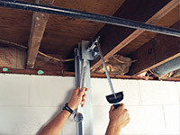 Straightening a foundation wall with the PowerBrace™ i-beam system in a Repentigny home.